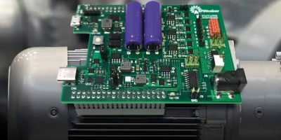 Motor control daughterboard aids provides space vector modulation